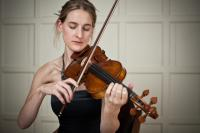 Olivia Moore playing violin by Emile Holba